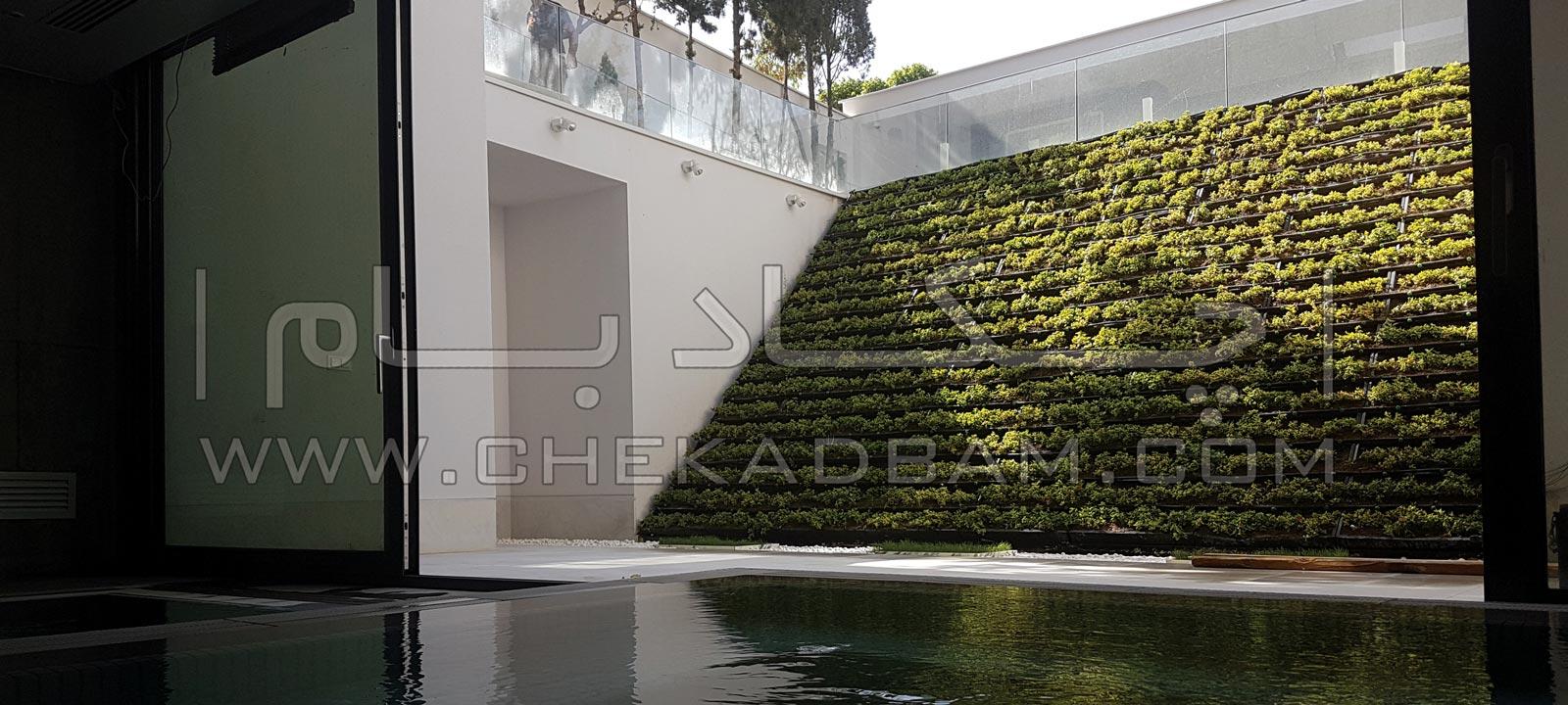 بنر اسلایدر دیوار سبز شیب دار و استخر آب در مجتمع مسکونی
