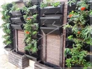 فلاورباکس های دیواری و آبنما و کاشت گیاه در پروژه محوطه سازی حیاط  ولیعصر