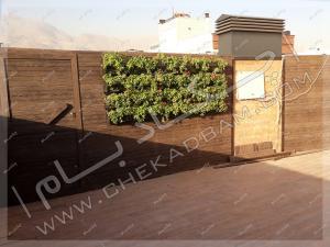دیوار سبز مدولار و دیوارکوب چوب پلاستیک روی پشت بام