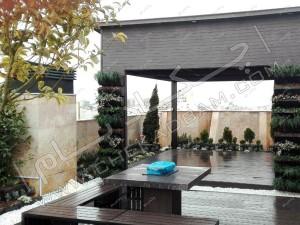 روف گاردن در ایران تهران خیابان دیباجی آلاچیق مدرن سبز و میز و نیمکت فضای باز