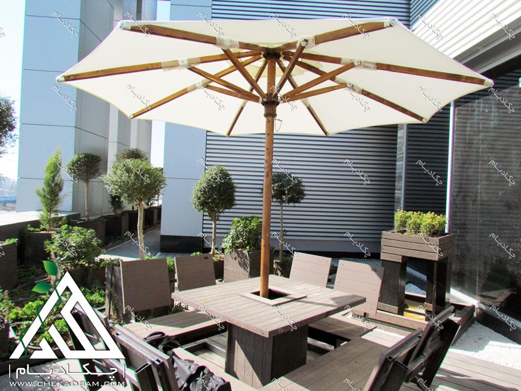 طراحی فضای سبز تراس بالکن کرج شرکت دارویی نانو الوند چتر حیاطی فضای باز میز و نیمکت محوطه green terrace balcony