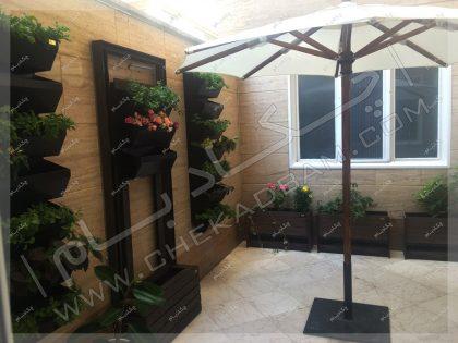 تزئین تراس کوچک سبز با گلدان ها و گیاهان مناسب تراس تهران گیشا
