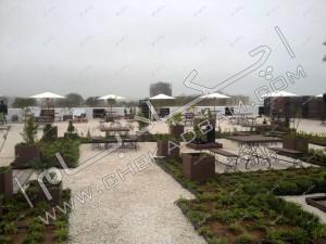 روف گاردن اکسین دریاسر شمال میز و چتر محوطه و فضای سبز روی پشت بام