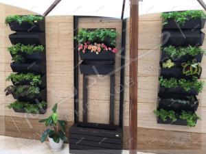 تراس سبز گیشا تزئین تراس کوچک با گلدان و گیاهان مناسب تراس و بالکن و چتر آفتابگیر