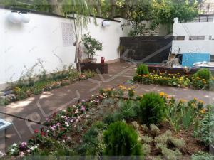 طراحی منظر حیاط و کف سازی چوبی متریال چوب پلاستیک الهیه تهران